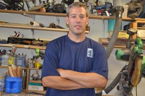 Adam Ross in wood working shop