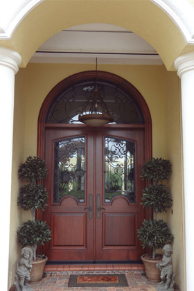 Ross Woodworking Built \u0026 Design 2¼\u201d thick solid mahogany arched top with radius transom custom Iron work \u2013 Red Mahogany Stain Satin Finish \u2013 Lakewood ... & Custom Doors - Adam Ross Woodworking